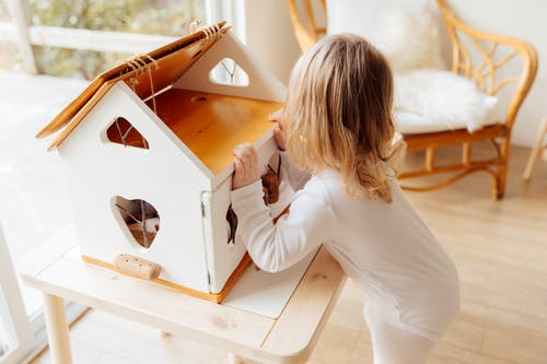 Girl Playing With A Wooden Box