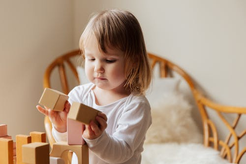 Photo Of Child Playing Wooden Blocks