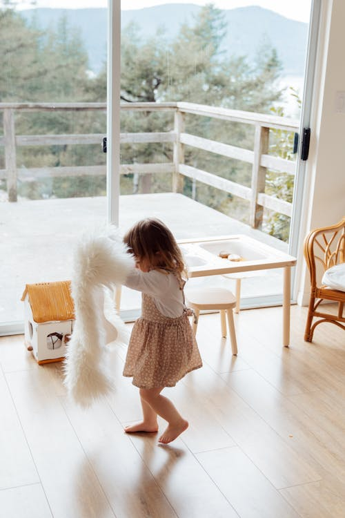 Photo Of Child Near Glass Door