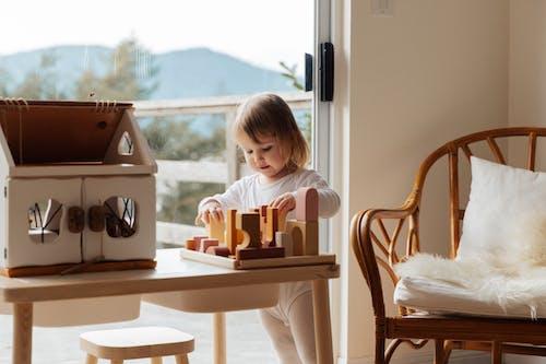 Photo Of Child Playing Wooden Blocks