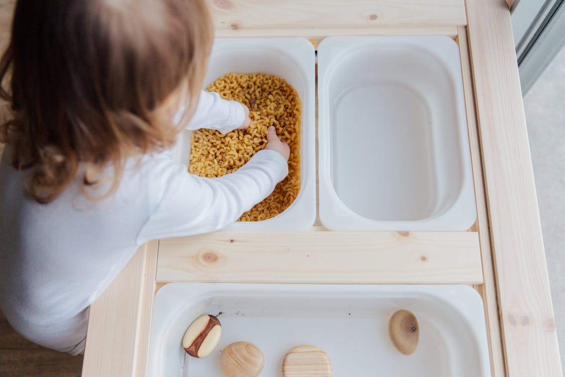 Photo Of Child Playing With Macaroni Pasta