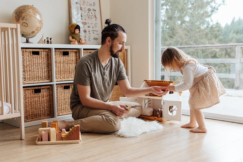 Photo Of Man Playing With Daughter
