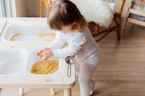 Photo Of Child Holding Macaroni Pasta