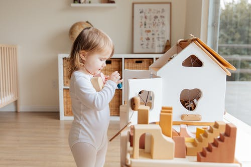 Photo Of Child Holding Wooden Blocks