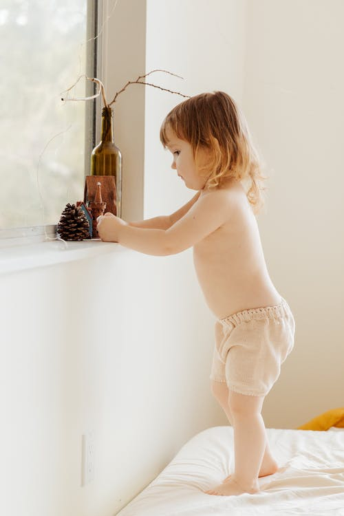 Photo Of Child Near Window