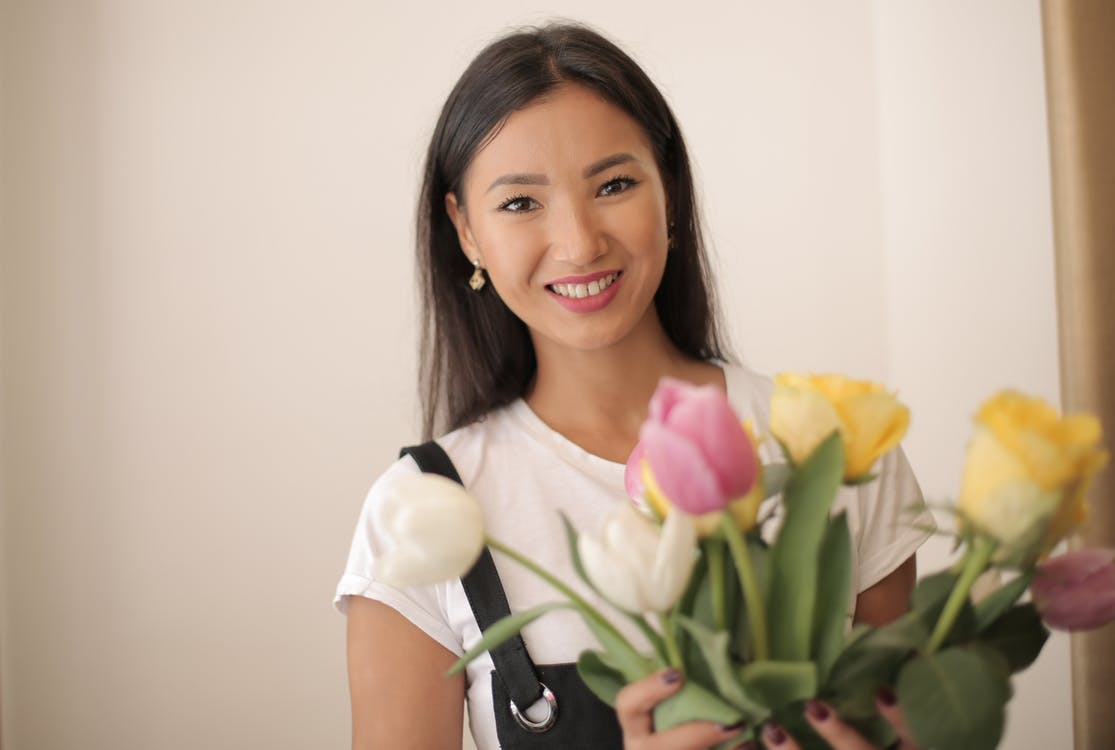Photo Of Woman Holding Flower Vases