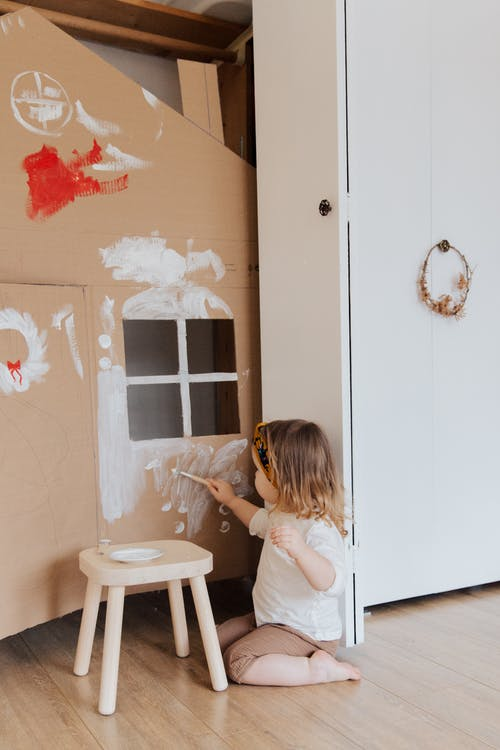 Girl Painting Cardboard House