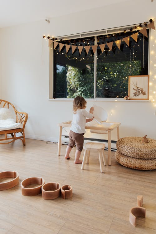 Photo Of Child Near Wooden Table