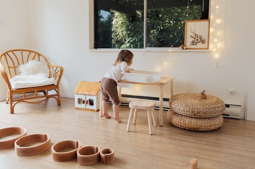 Photo Of Child Leaning On Wooden Table