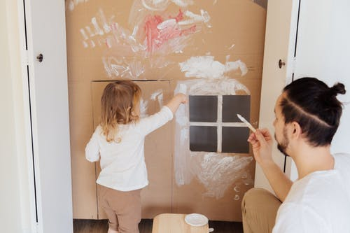 Photo Of Child Painting Cardboard