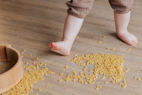 Child Stepping on Macaroni
