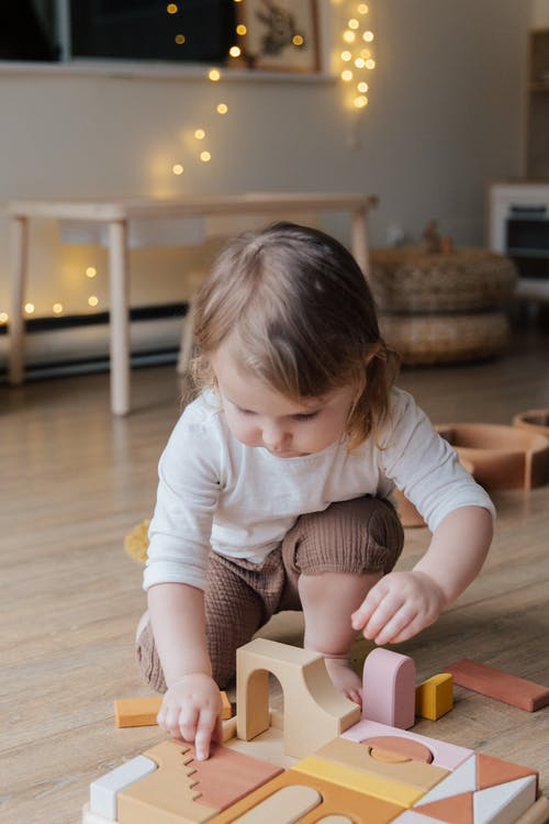 Photo Of Child Playing With Wooden Blocks