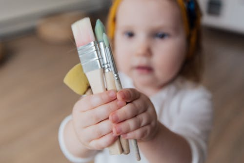 Photo Of Toddler Holding Brushes