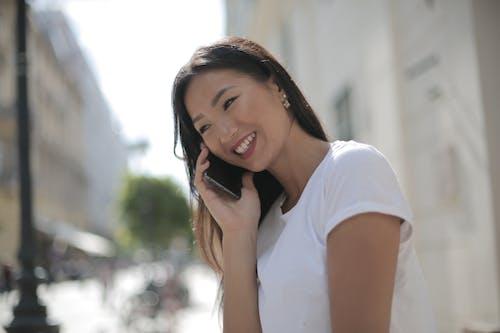 Photo Of Woman Wearing White Shirt