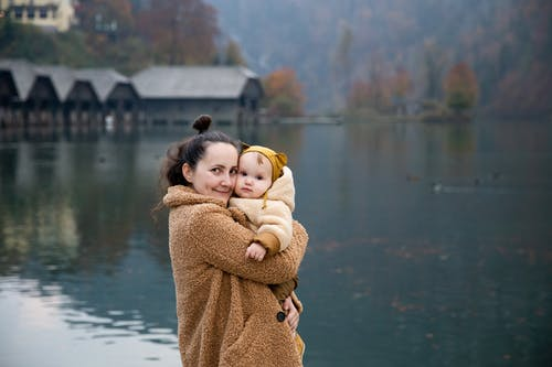 Photo Of Woman Hugging Baby