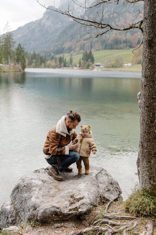 Photo Of Man Holding Baby