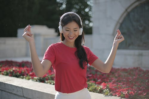 Photo Of Woman Wearing Red Shirt