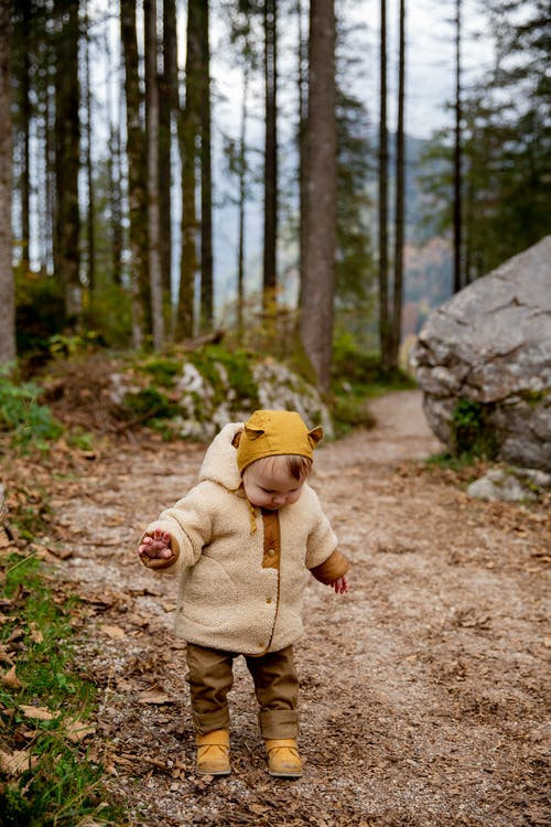Photo Of Baby Standing On Dirt Road