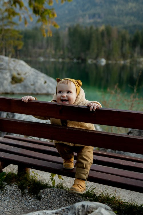 Photo Of Baby On Wooden Bench
