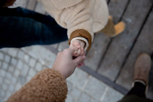 Photo Of Person Holding Baby's Hand