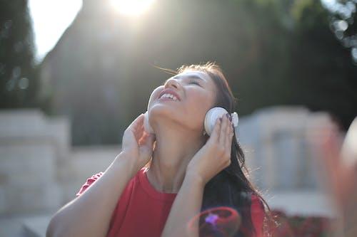 Photo Of Woman Holding Headphones