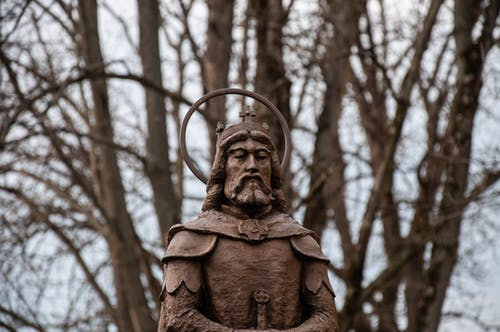 Ancient sculpture of holy warrior in park
