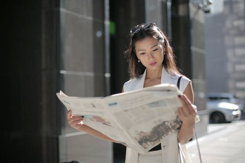Photo Of Woman Holding Newspaper