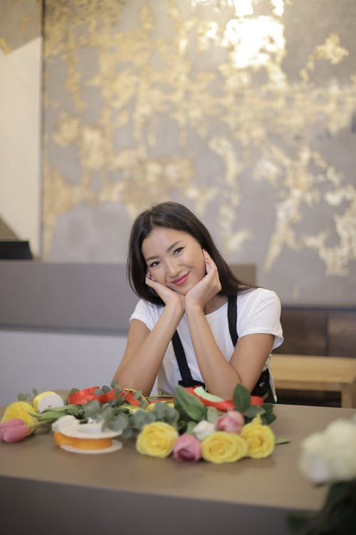 Woman in White Shirt Smiling