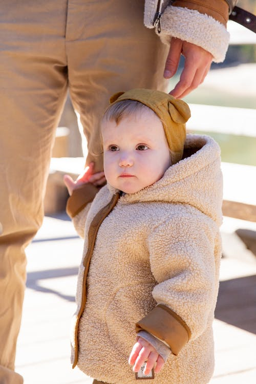 Baby in Brown Sweater Standing