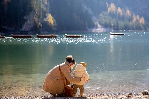 Mother and Child Near Body of Water