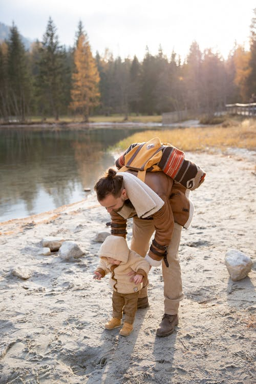 Photo Of Man Holding Baby