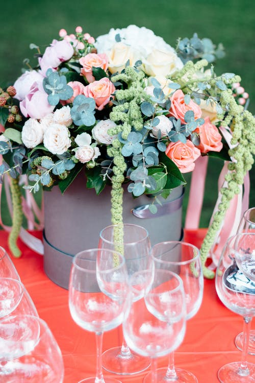 Photo Of Flowers Near Wine Glasses