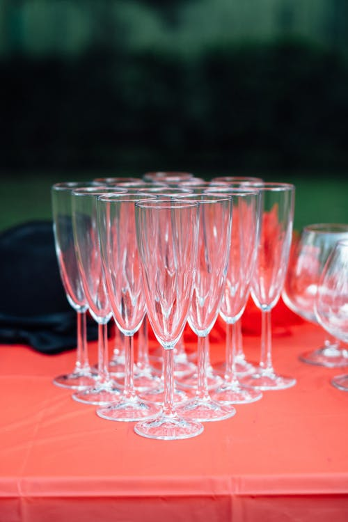 Clear Drinking Glasses on Red Table