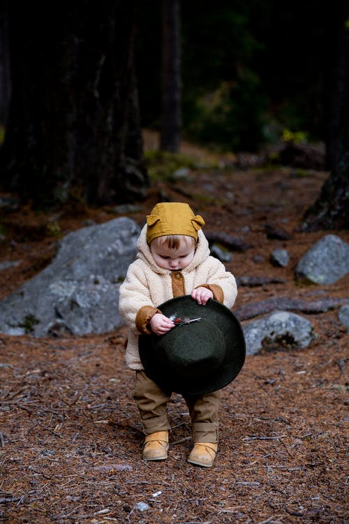 Photo Of Baby Holding Fedora Hat