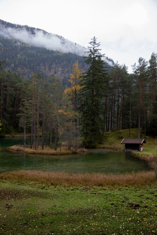 Photo Of House Beside Lake