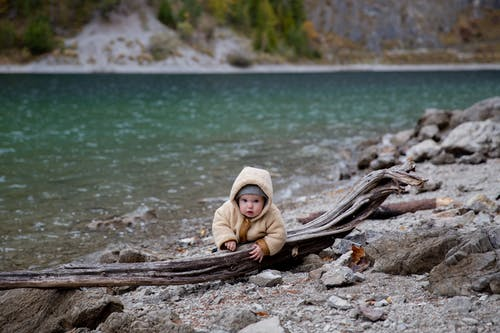 Cute Little Kid Near Body of Water