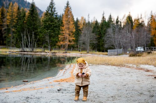 Photo Of Baby Near Lake