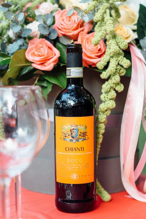 Photo Of Wine Bottle Beside Flowers