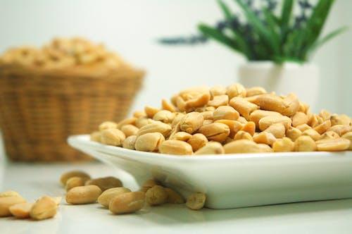 Бесплатное стоковое фото с арахис, гайки, еда, тарелка