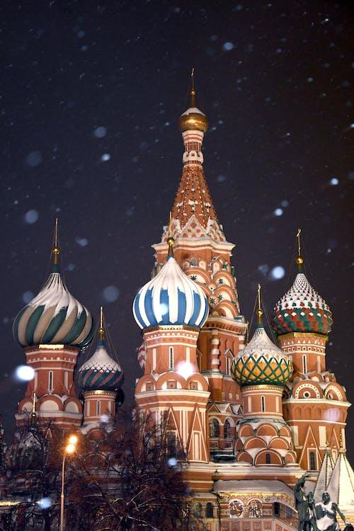 Saint Basil's Cathedral at Night During Snowfall