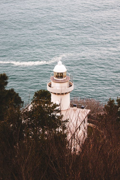Photo Of Lighthouse Beside Sea
