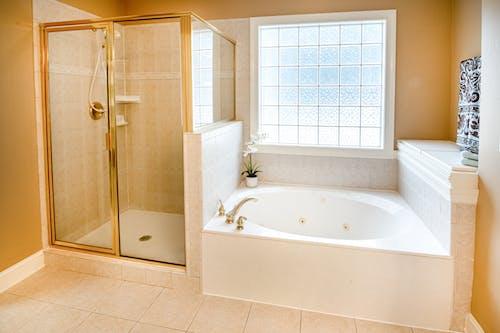 Photo Of Ceramic Bathtub Near Window