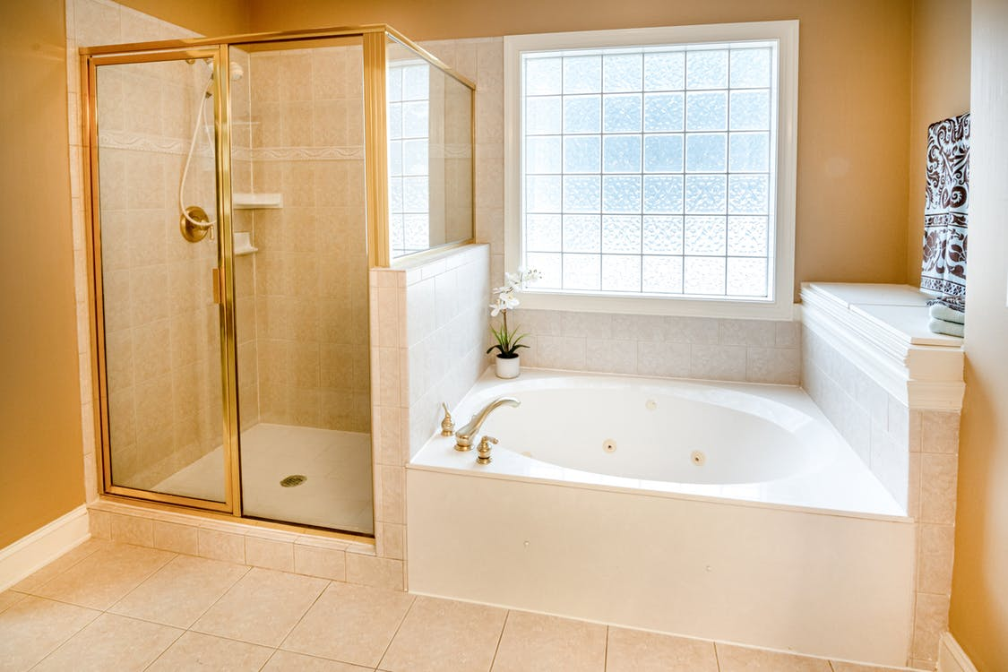 Photo Of Ceramic Bathtub Near Window