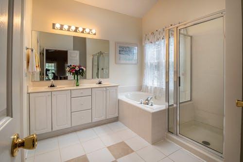 Photo Of Ceramic Sink Near Bathtub
