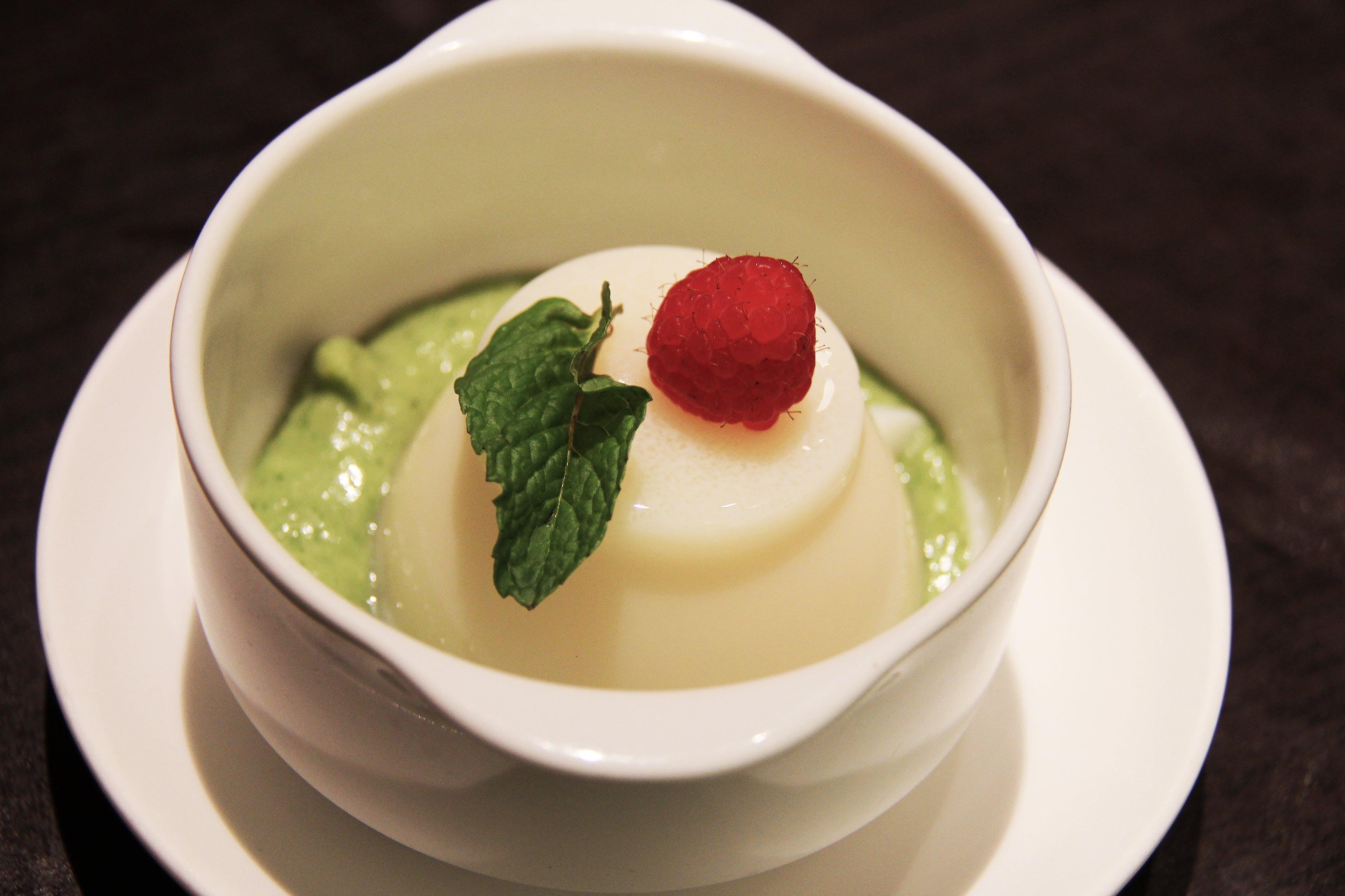 White Ceramic Bowl With White and Green Cream
