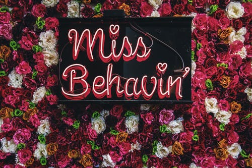 Miss Behavin' Sign On Flowers