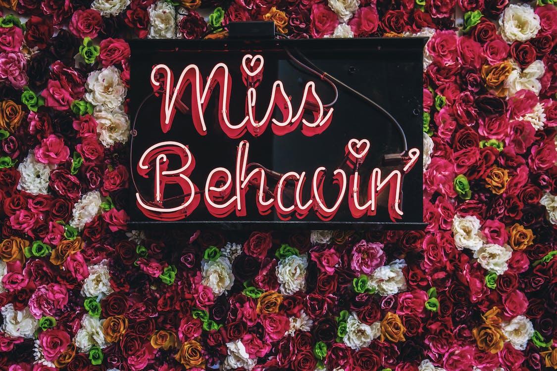 Miss Behavin' Sign On Flowers