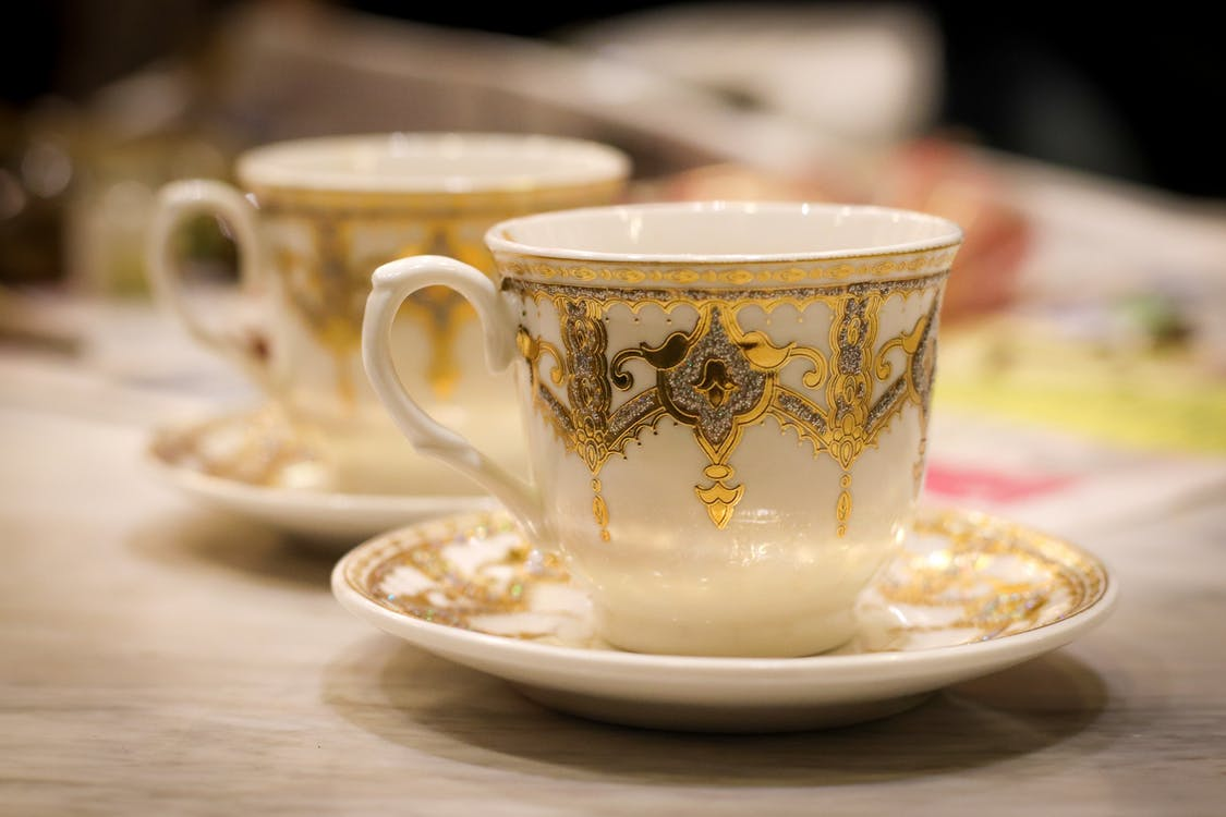 White and Golden Ceramic Teacup on Saucer