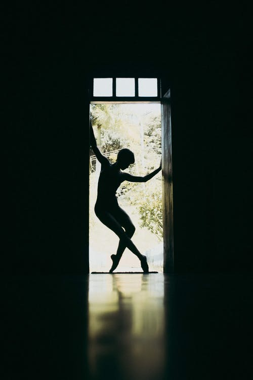 Silhouette of Woman Dancing By The Door
