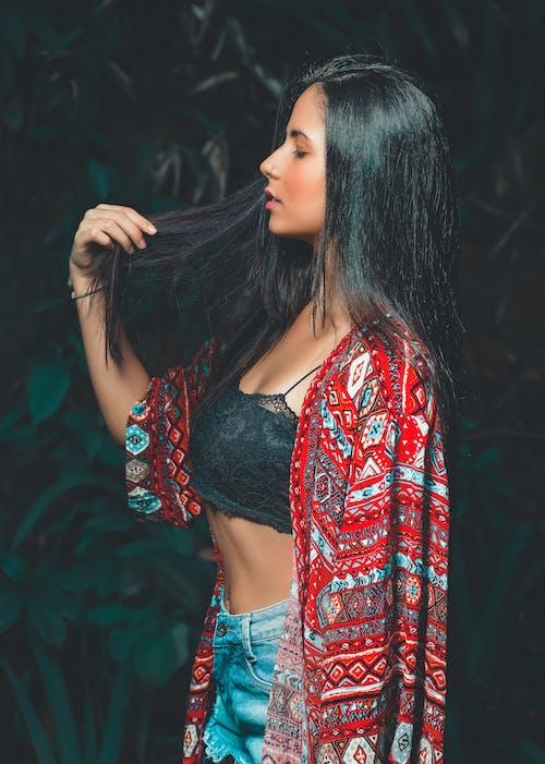 Photo of Woman Wearing Denim Shorts